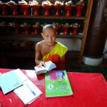 A Young Monk with his Homework
