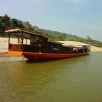 Docking at the Sand Dunes Along the Mekong