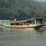 A Longboat on the Mekong