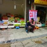 Combination Sidewalk Fruit Stand and Barber Shop