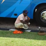 A Resident Snake Charmer Greets a Tour Bus
